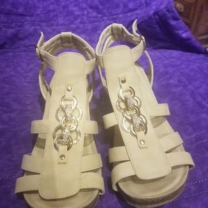 Beige strap sandals with gold decorations